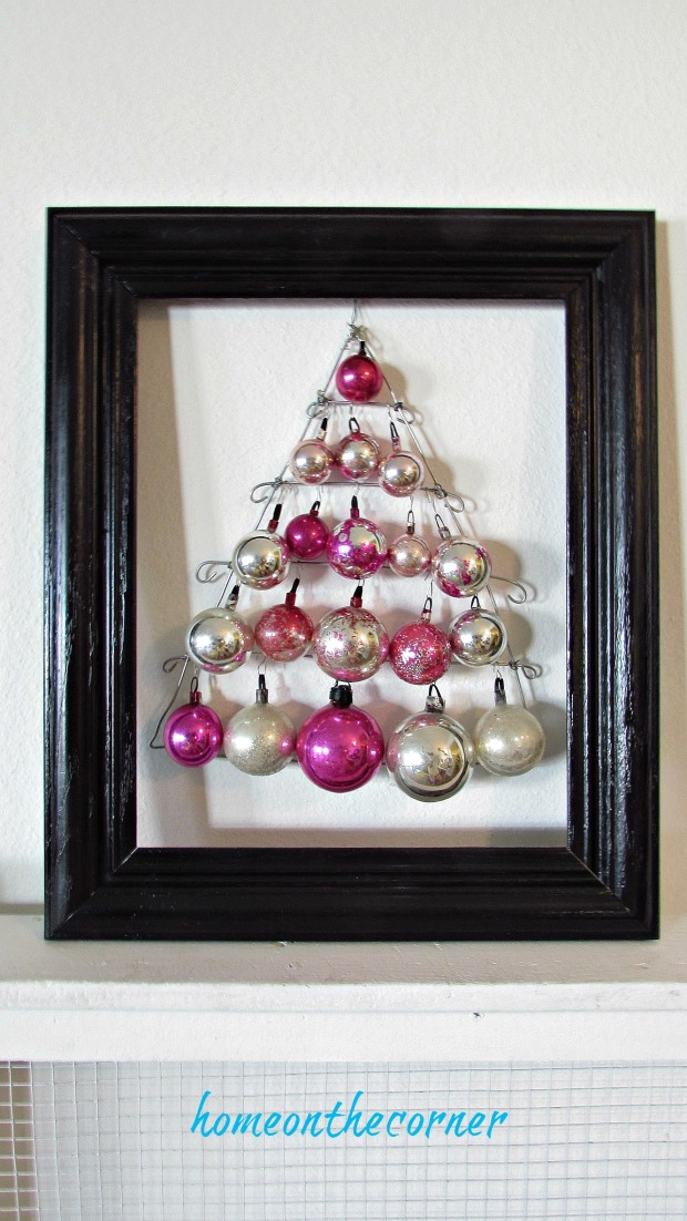 pink christmas ornament tree with black frame