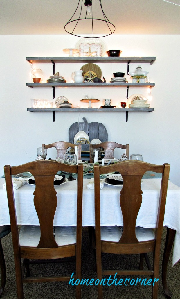 ear.y fall dining room table and lighted shelves