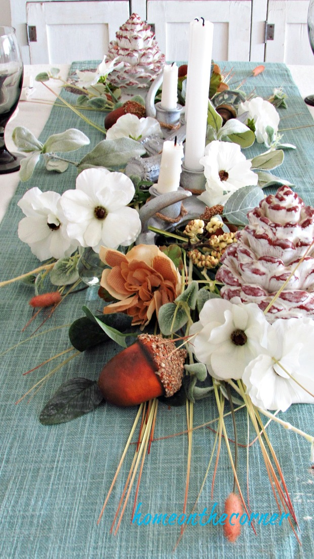 early fall dining room flowers and acorns centerpiece