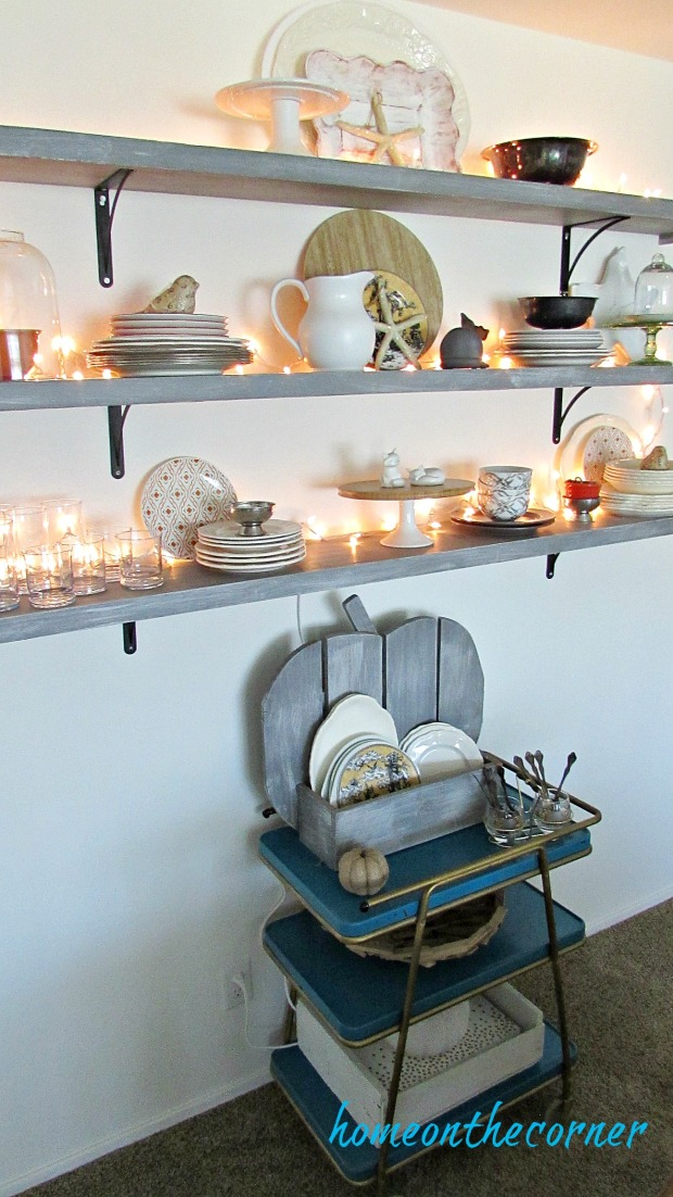 early fall dining room lighted shelves bar cart