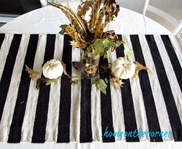 fall 2018 back patio black and white table centerpiece leaves and feathers