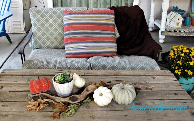 fall 2018 back patio couch and pumpkins