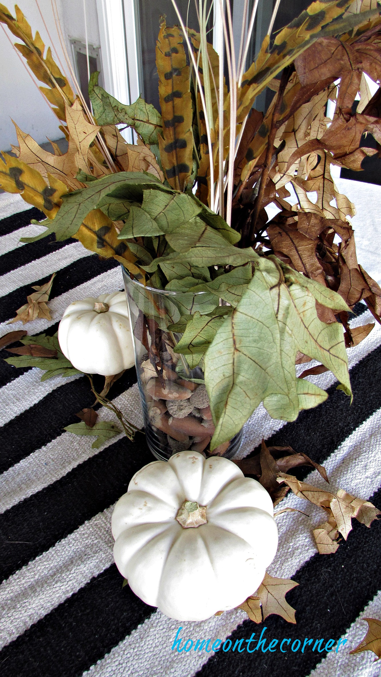 fall 2018 back patio table centerpiece with pumpkins