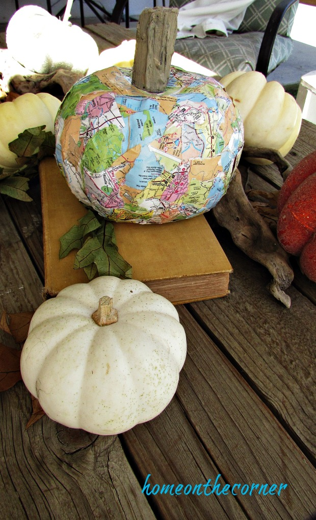 travel map pumpkin with small white pumpkins