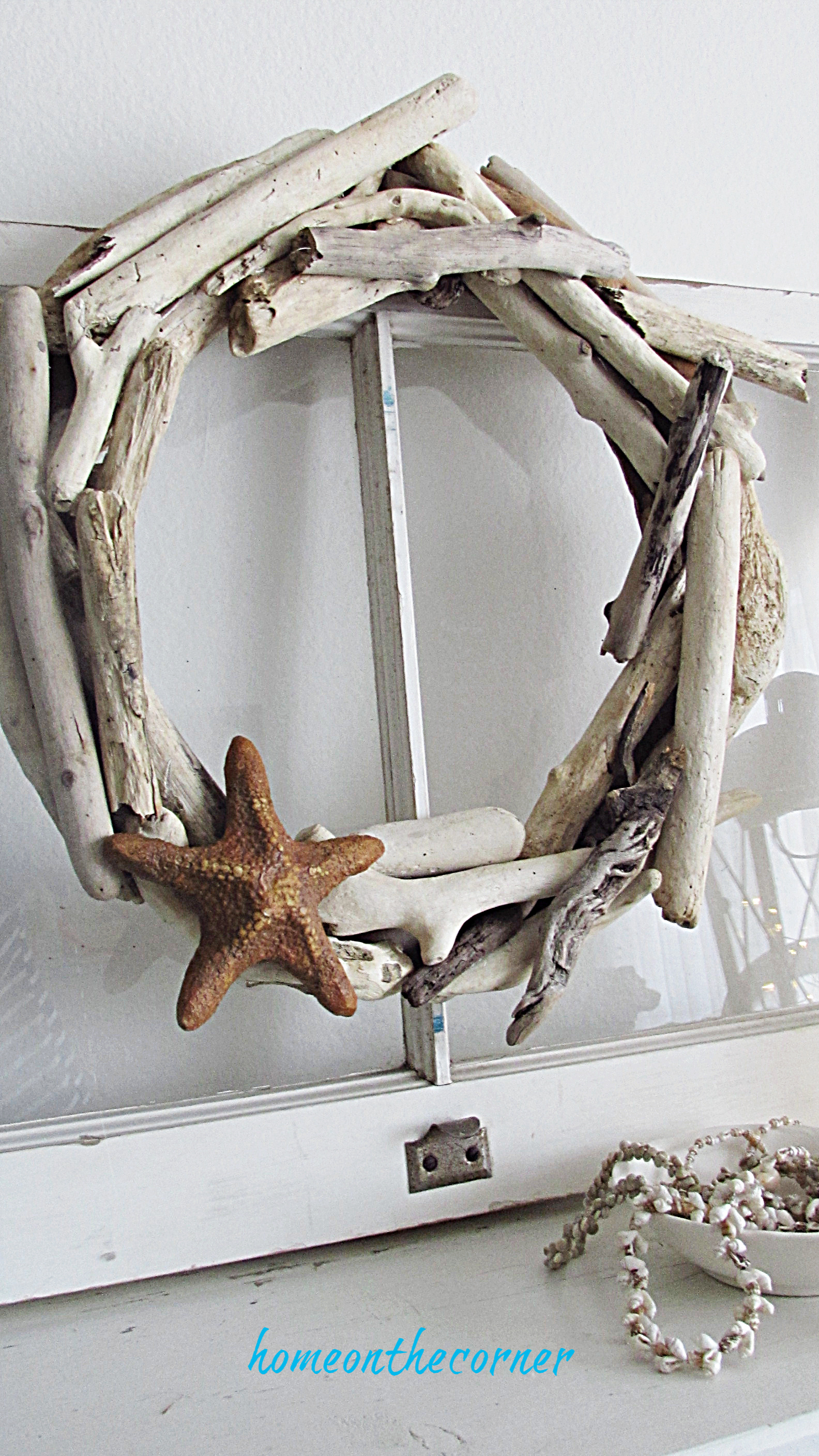 driftwood wreath mantle and shells