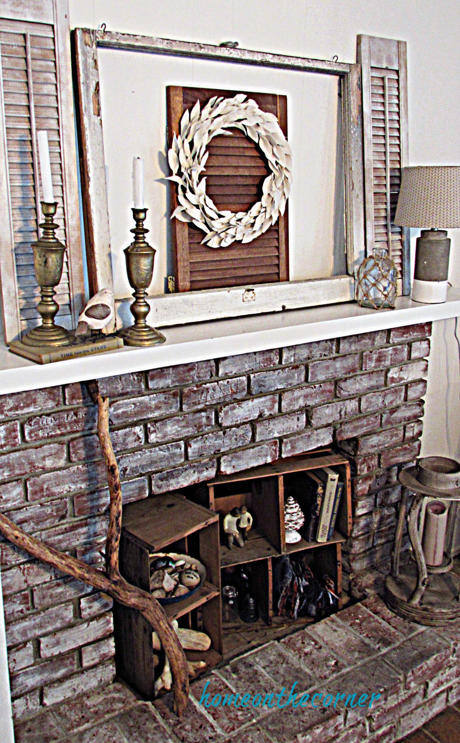 drop cloth leaf wreath hanging mantle fireplace