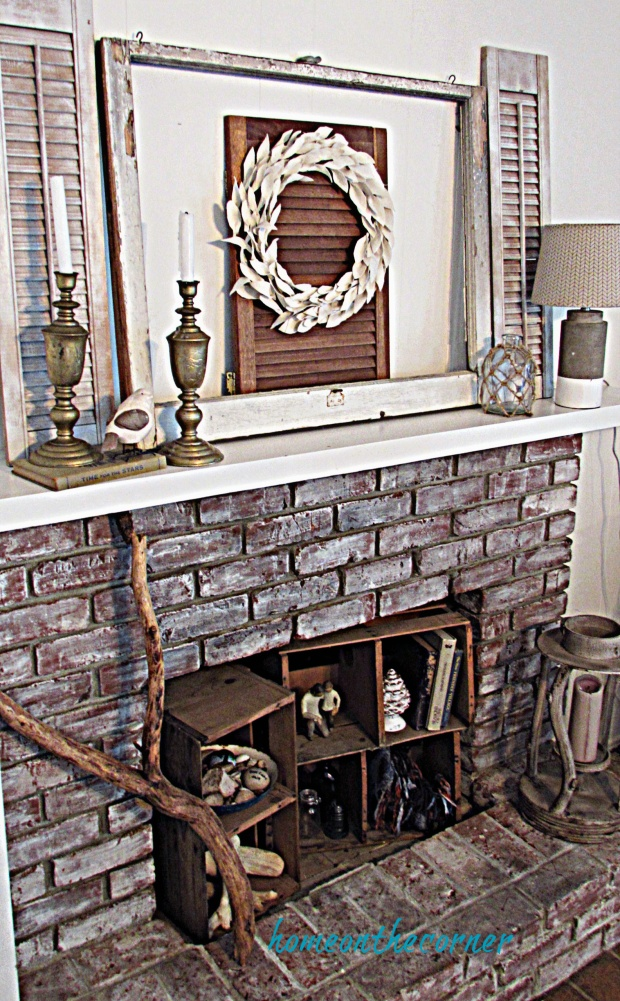 drop cloth leaf wreath hanging mantle fireplace