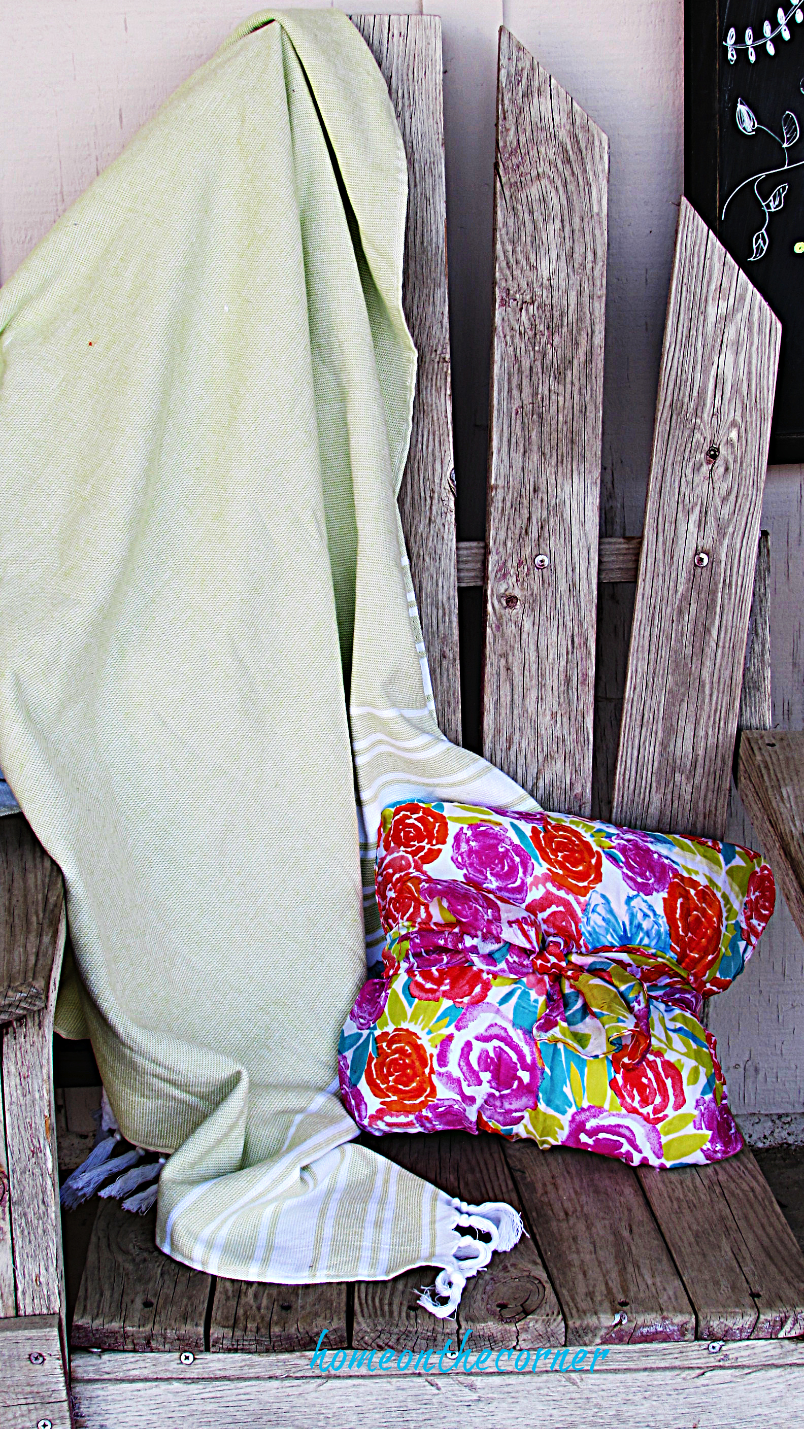 spring porch green blanket and floral pillow