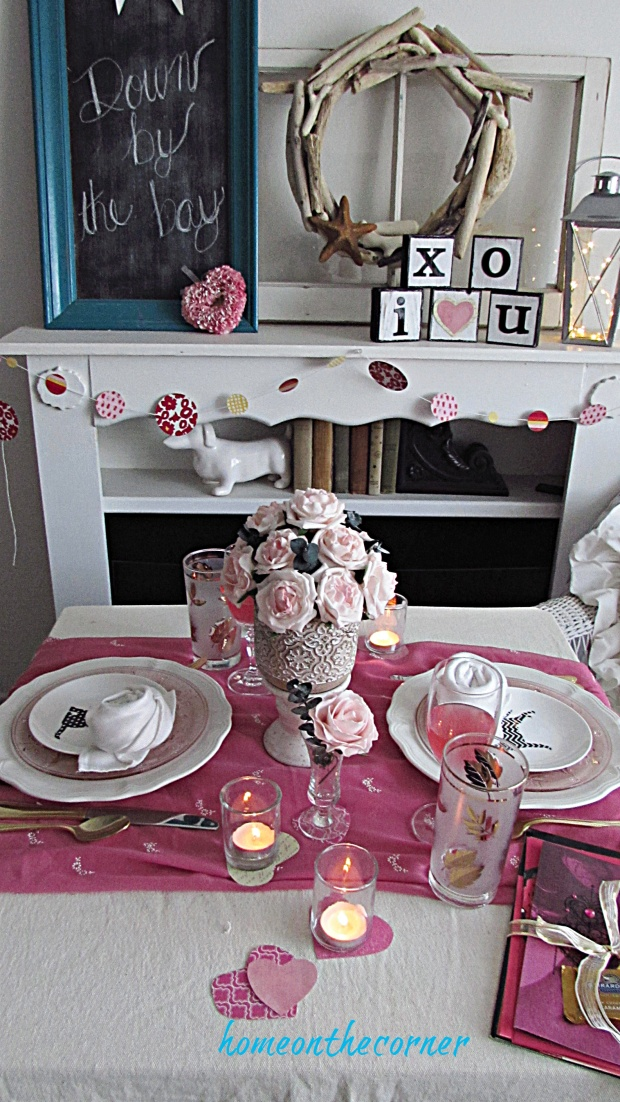 valentine tablescape pink, gold and shite hearts, flowers, candles
