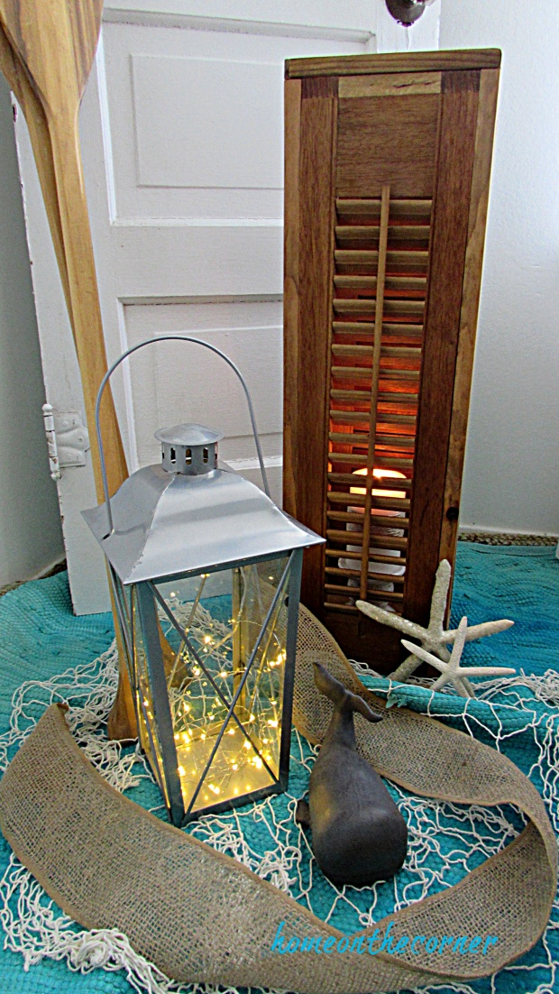 shutter lantern with candle and starfish
