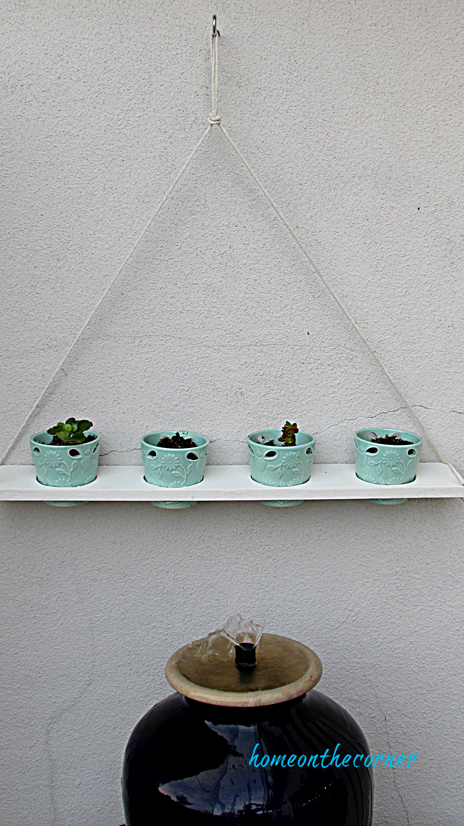 hanging plant holder and fountain