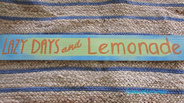lazy days wood sign with orange writing