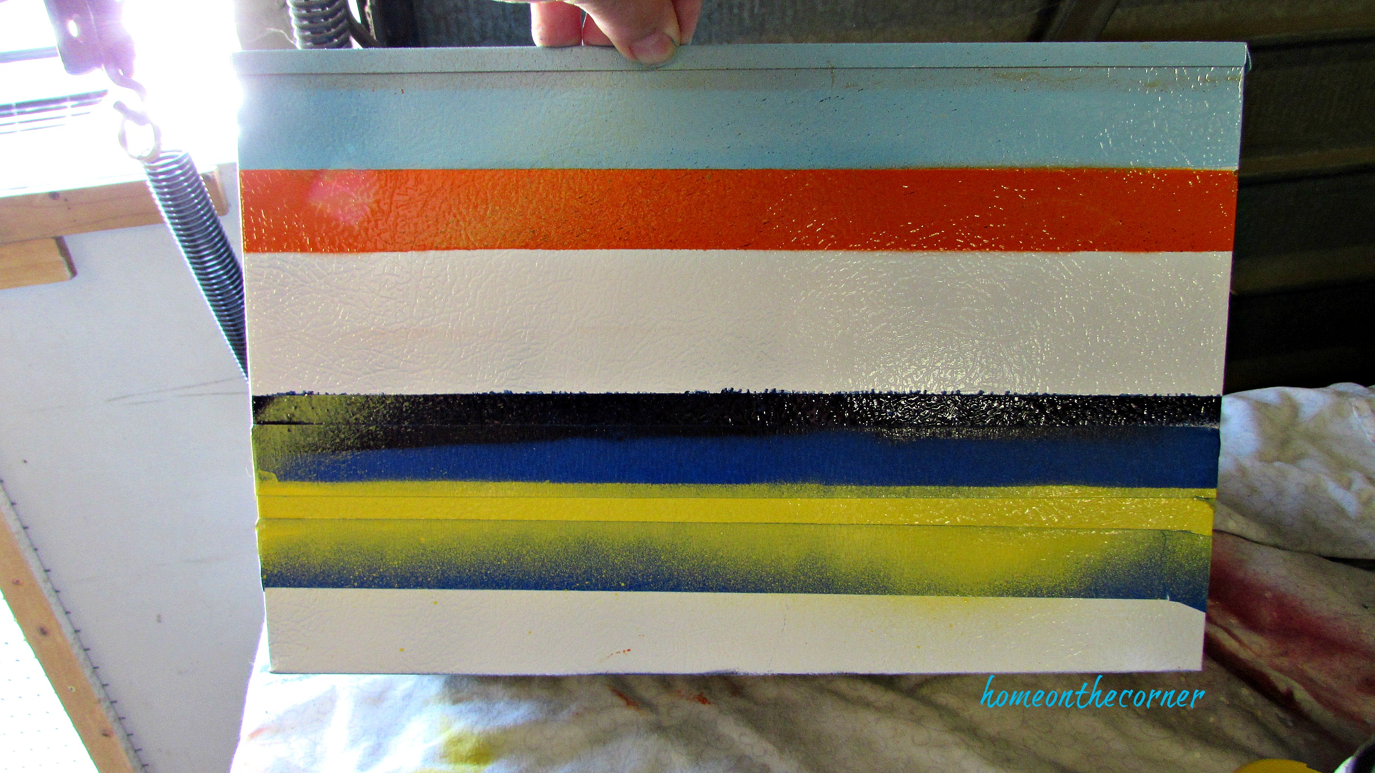 metal box spray paint stripes orange, turquoise