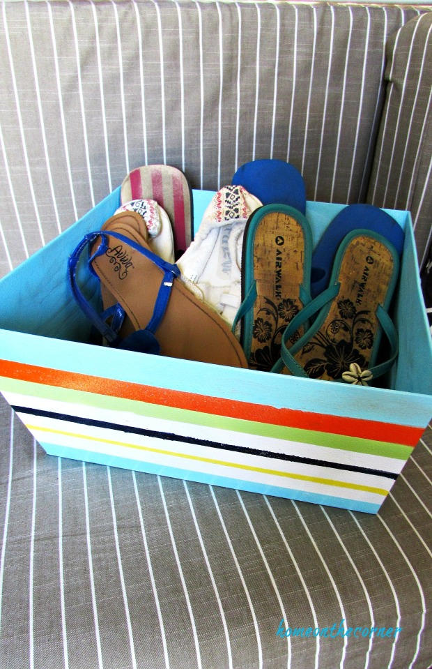 metal box with painted stripes storing shoes