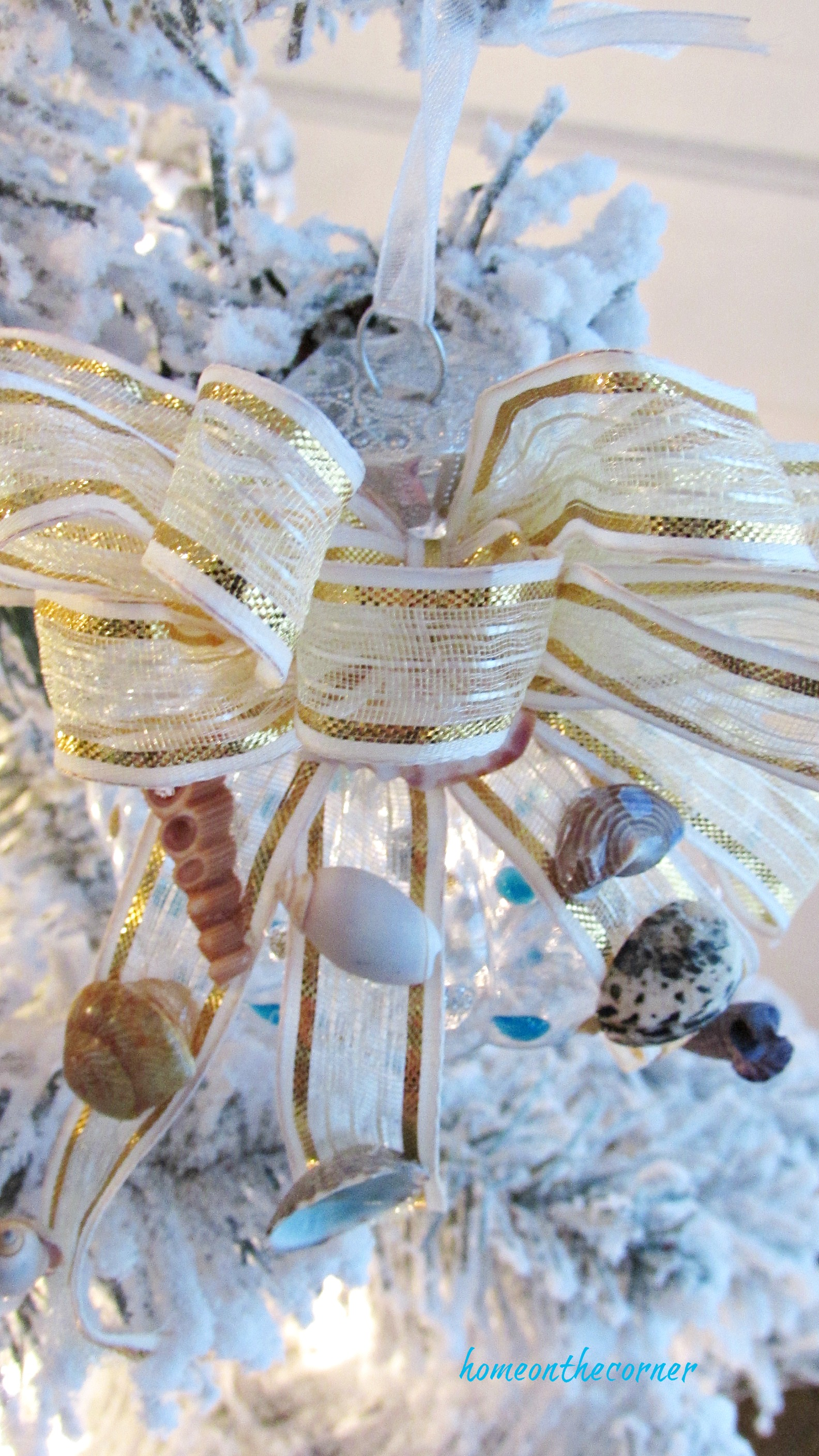 christmas ornament exchange gold and seashells