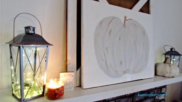 cream pumpkin fall mantle lanterns and candles