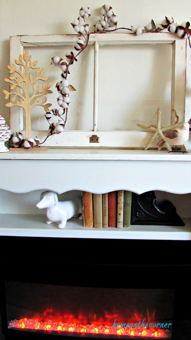 fall living room mantle with cotton, tree, starfish