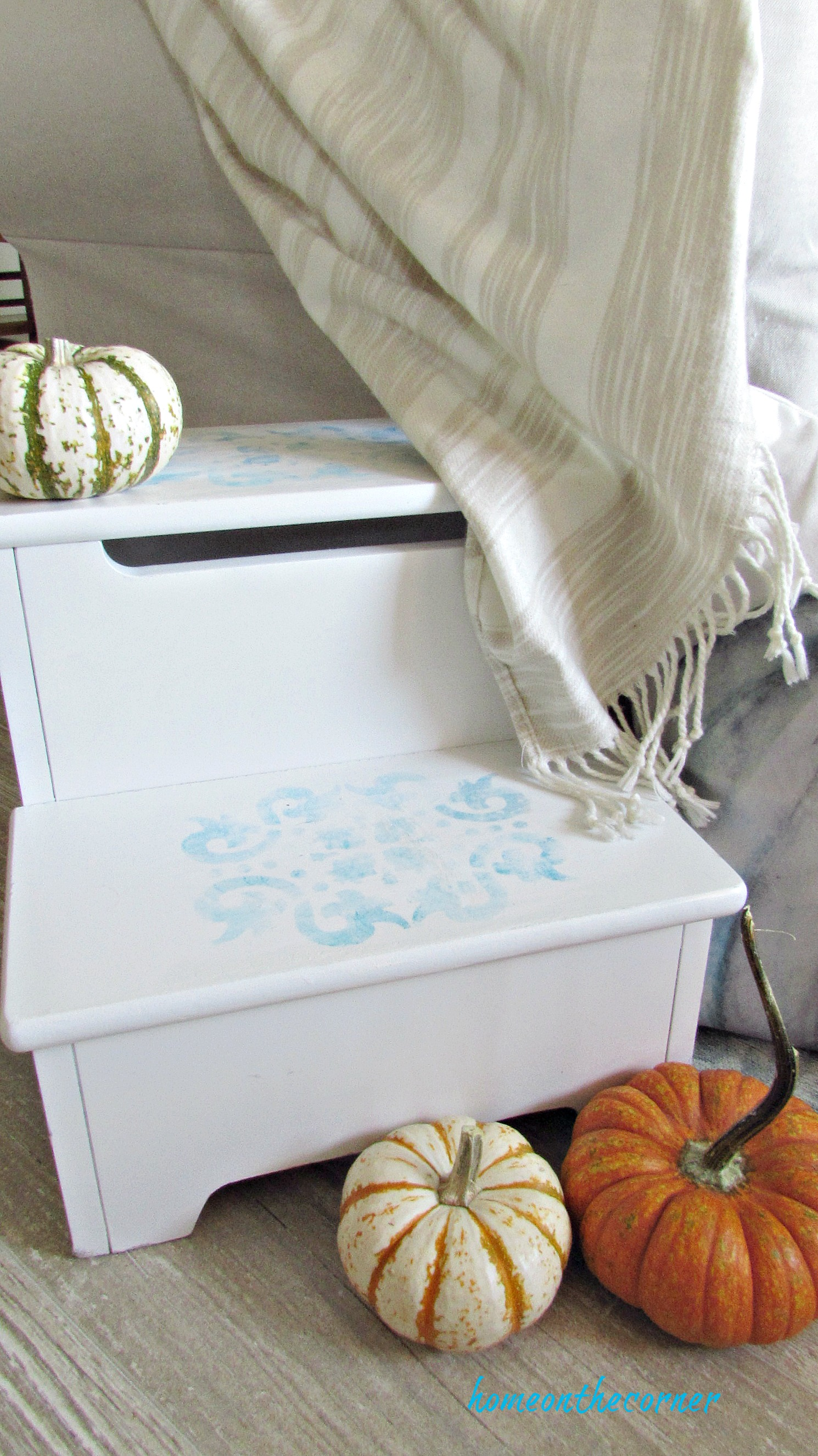 step stool makeover pumpkins and blanket