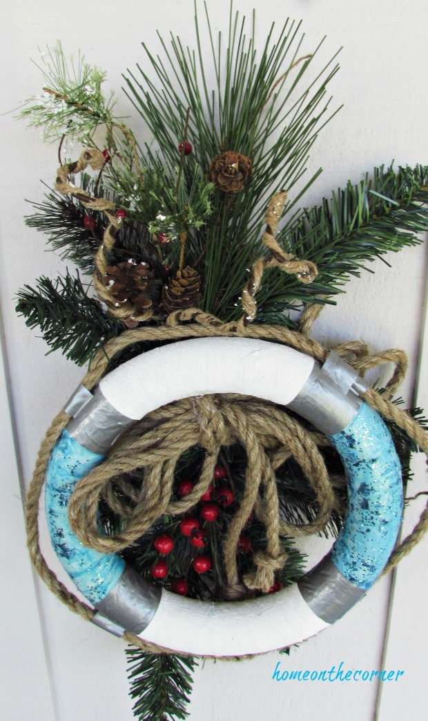 christmas wreath buoy rope and pinecones