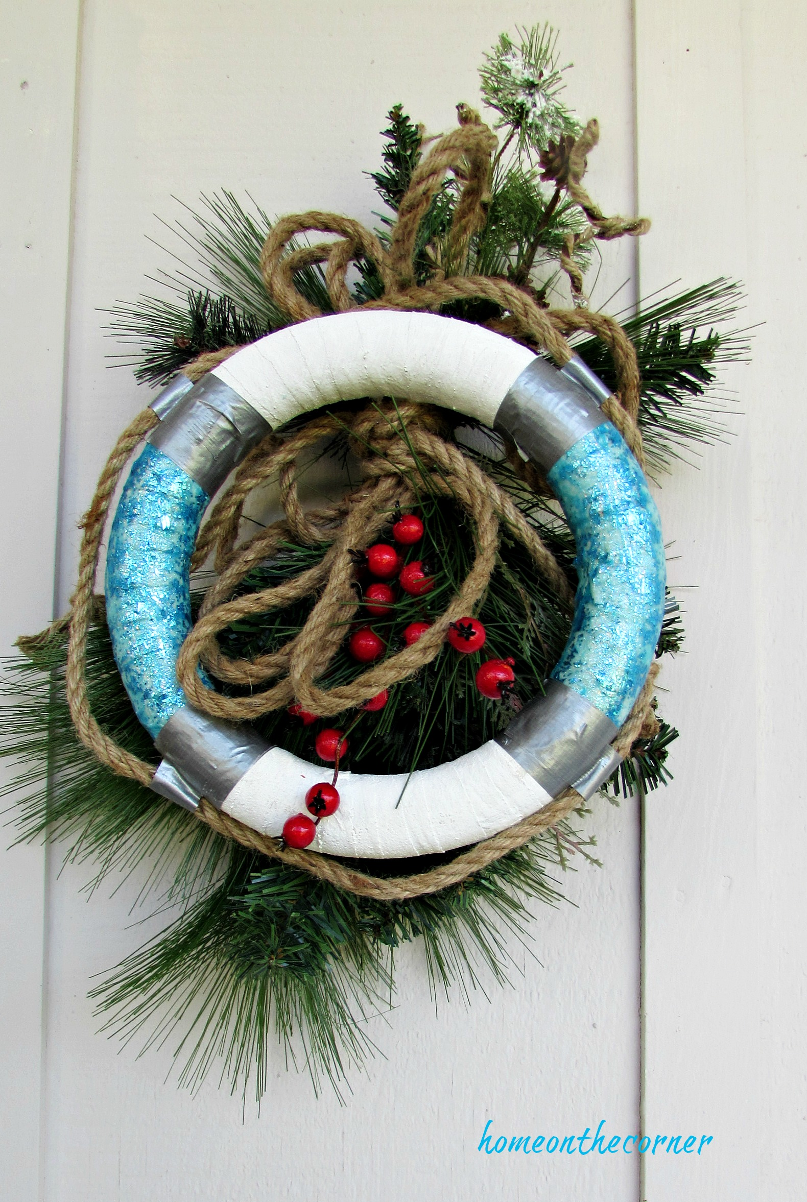 christmas wreath life buoy rope, greens, rope and berries