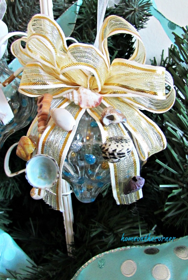 turquoise ornament gold bow and seashells