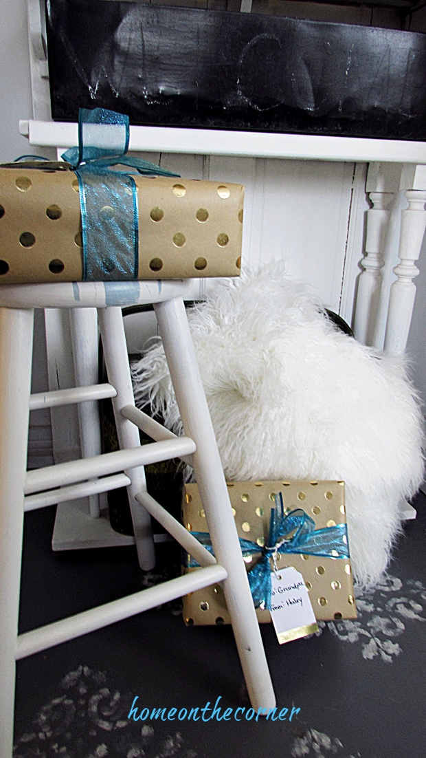 Christmas entryway wrapped gifts fur throw